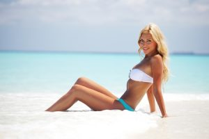 Can I Swim and Go to the beach With Hair Extensions? - Glo Extensions Denver Salon