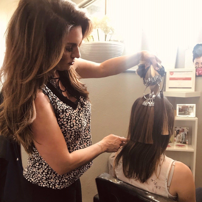 hair extensions consultation at Glo salon denver